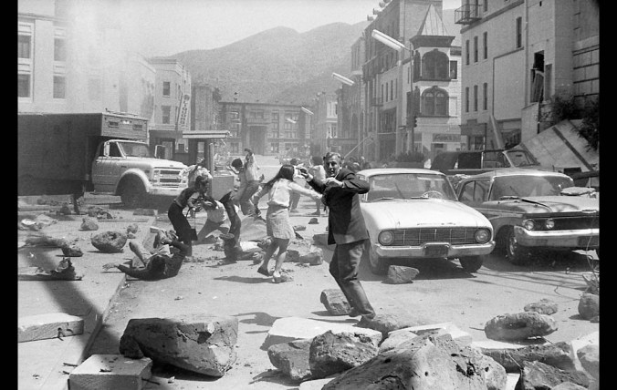 May 3, 1974: Actors dodging rubble during filming of motion picture