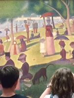 Young couple looking at Seurat.
